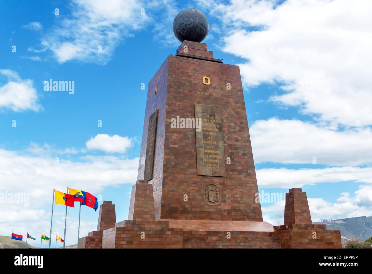 Monument to the Equator in Quito, Ecuador with the Ecuadorian flag in the bottom left - Stock Image