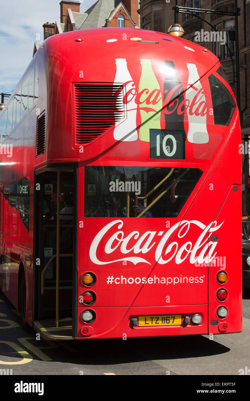 A red London Routemaster double-decker bus with Coca-Cola