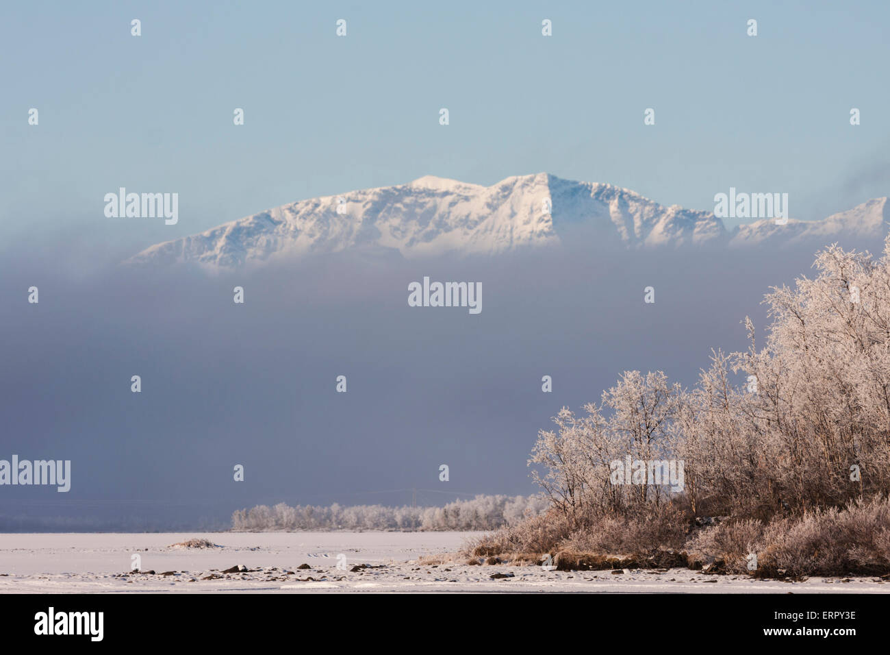 The top of mount Kebnekaise seen above a wall of fog in early winter in october at Kiruna, Sweden, Swedish lapland - Stock Image