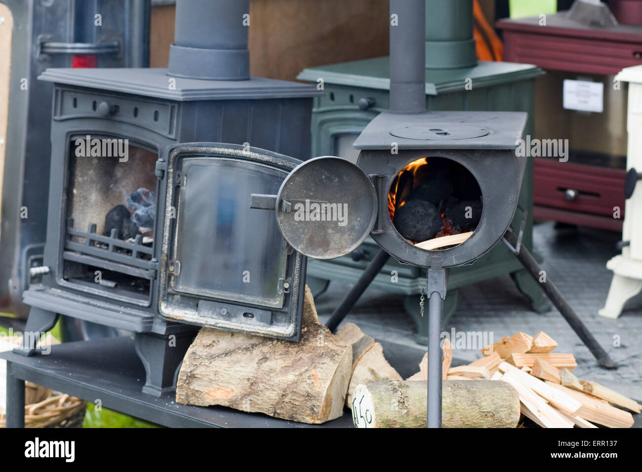 wood burning canal boat cast iron stoves - Stock Image