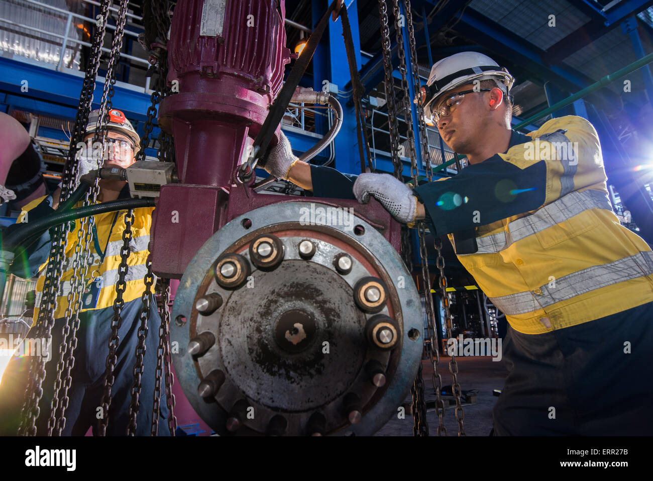 Workers doing maintenance work at power plant. - Stock Image