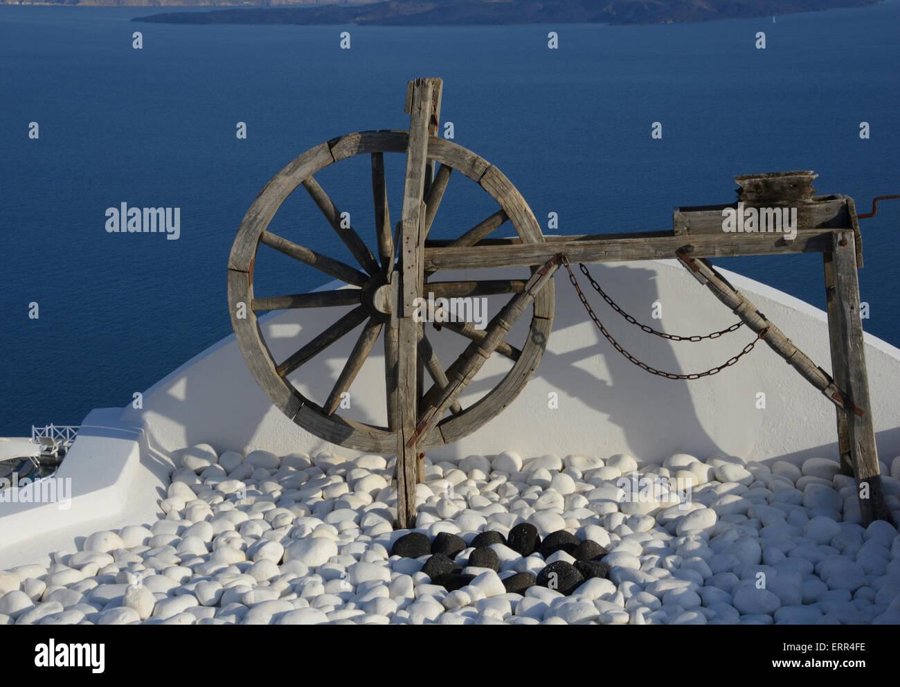 Wooden artefact displayed on rooftop, Oia, Santorini, Greece - Stock Image