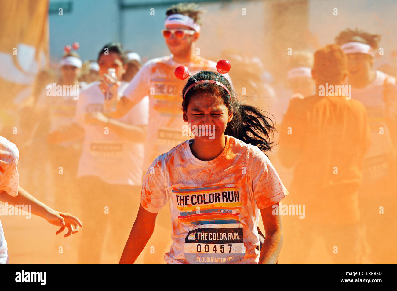 The Color Run Wembley, UK. Runners covered in coloured powder. London. Space for copy - Stock Image