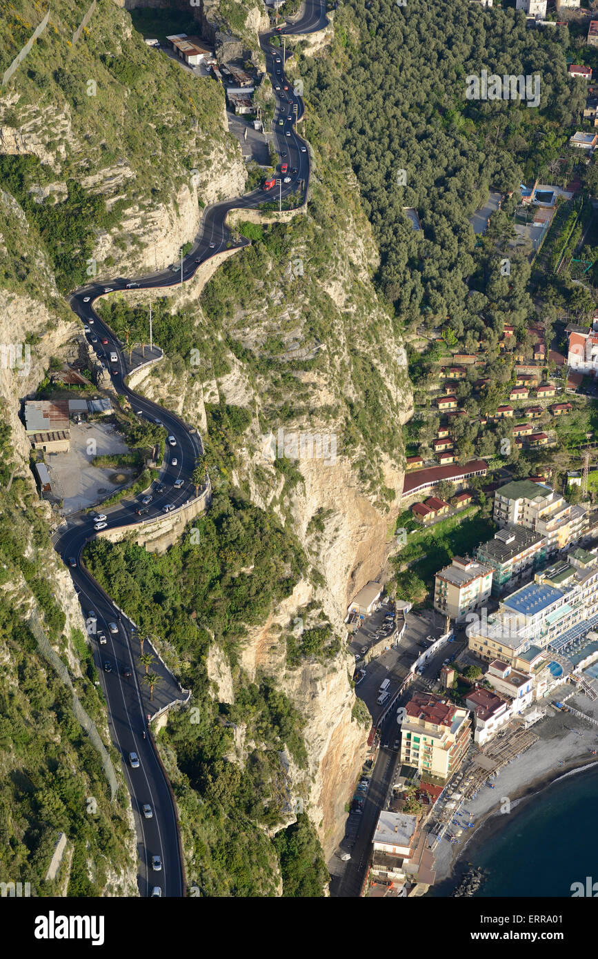 ROAD ON THE EDGE OF A CLIFF (aerial view). Meta di Sorrento, Metropolitan city of Naples, Campania, Italy. - Stock Image