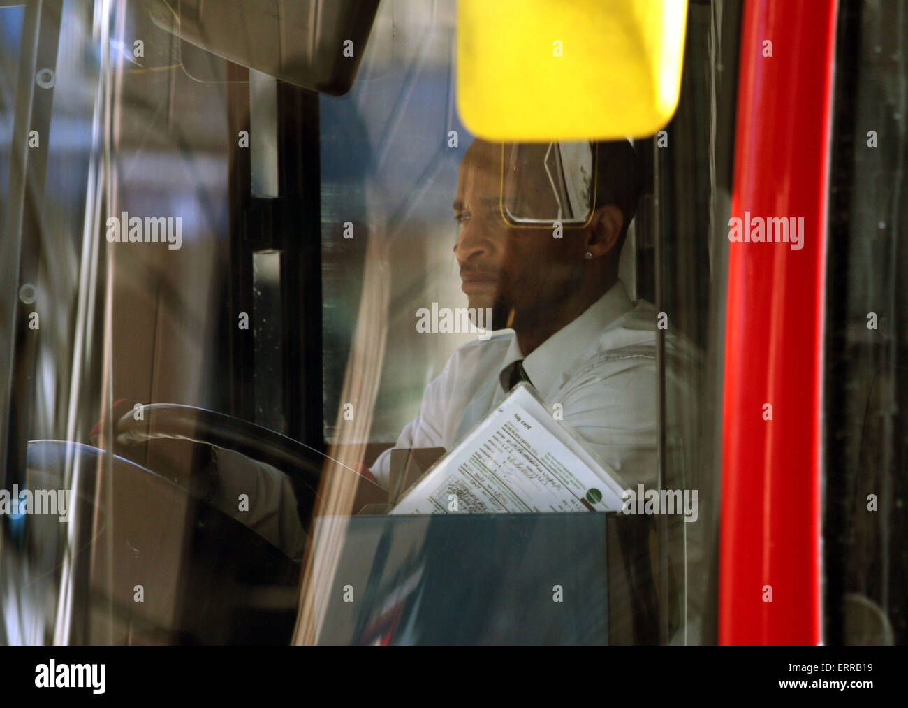 Bus driver London stuck in traffic jam driving red - Stock Image