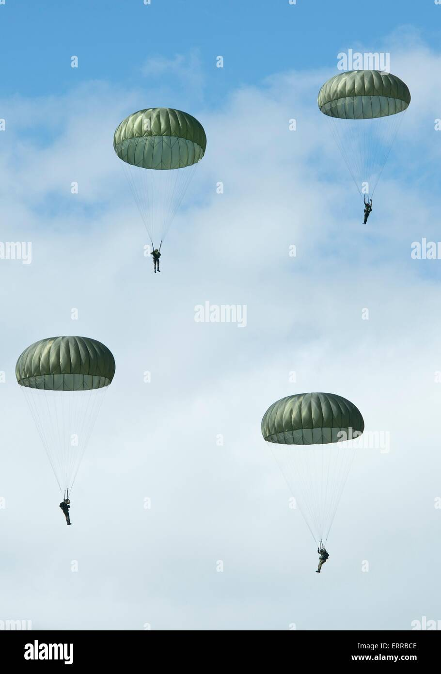 US Army paratroopers parachute over the historic La Fiere drop zone to commemorate the 71st Anniversary of D-Day - Stock Image