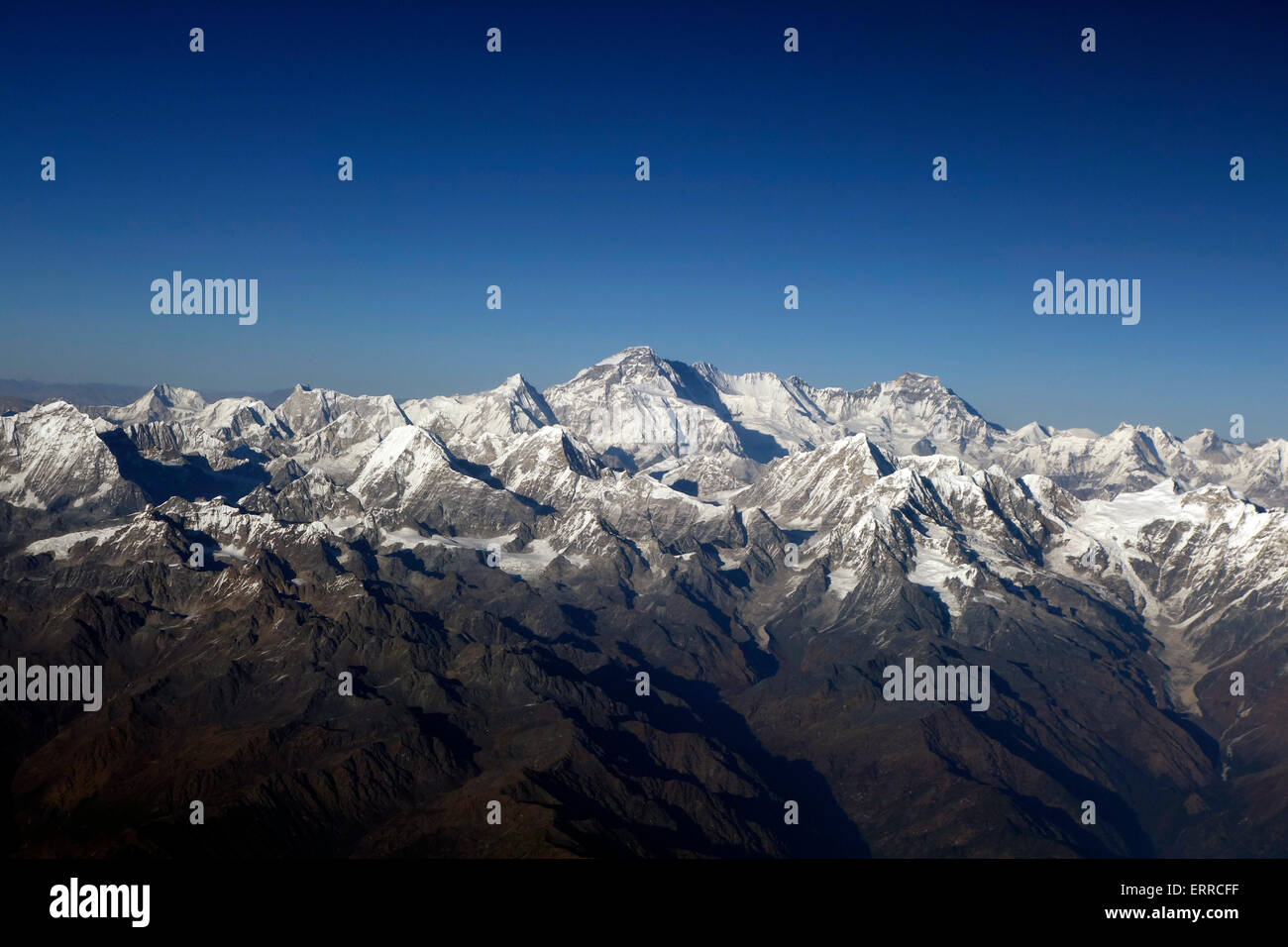 Aerial view of Mount Everest and the Himalaya mountains as seen from an airplane from Nepal to Bhutan - Stock Image