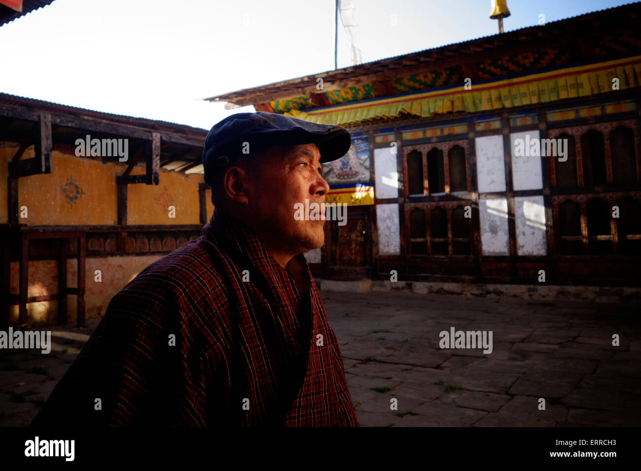 A Buddhist devotee at the courtyard of Tamshing Lakhang temple formally the Tamshing Lhendup Chholing (Temple of - Stock Image