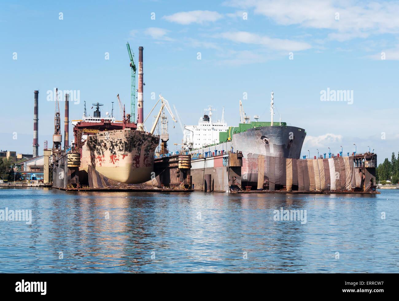 Two ships in major renovation in ship repair yard in Gdansk, Poland - Stock Image