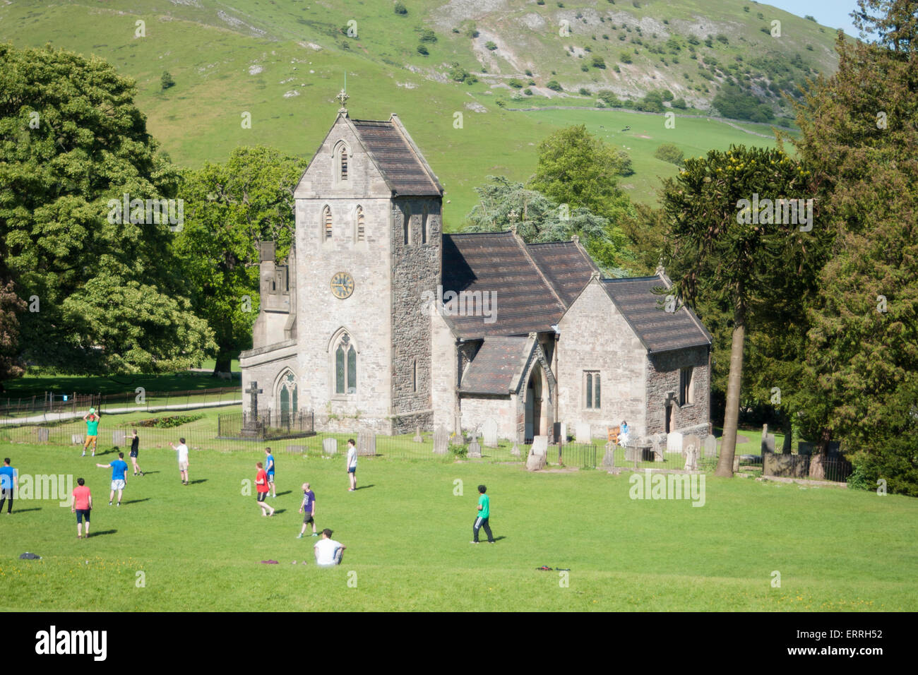 Church of the Holy Cross, viewed from the grounds of Ilam Hall, Ilam village, Staffordshire Peak District, UK - Stock Image