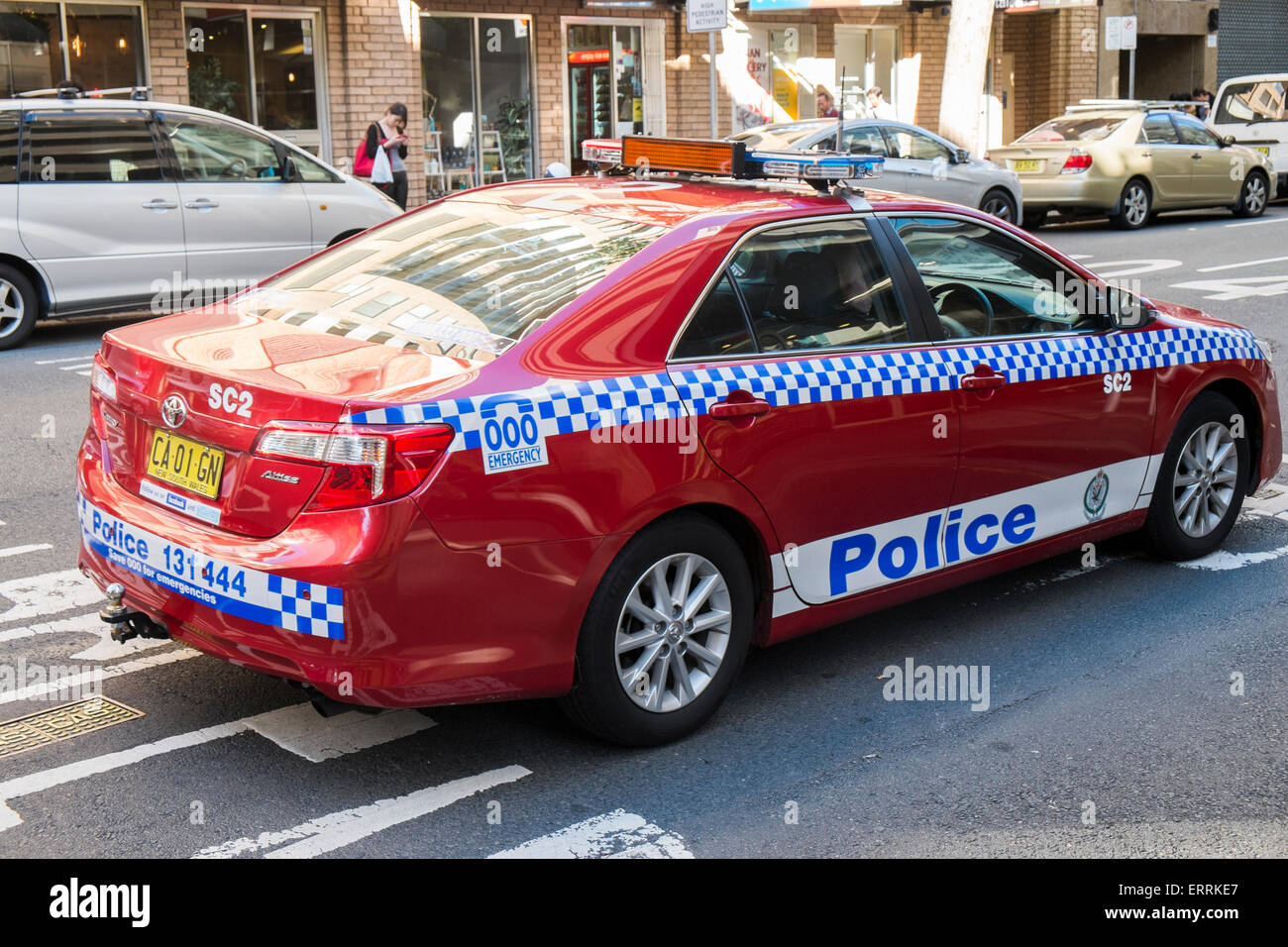 Police Officer In Sydney Driving A Red/maroon Toyota Police Car ,sydney,australia