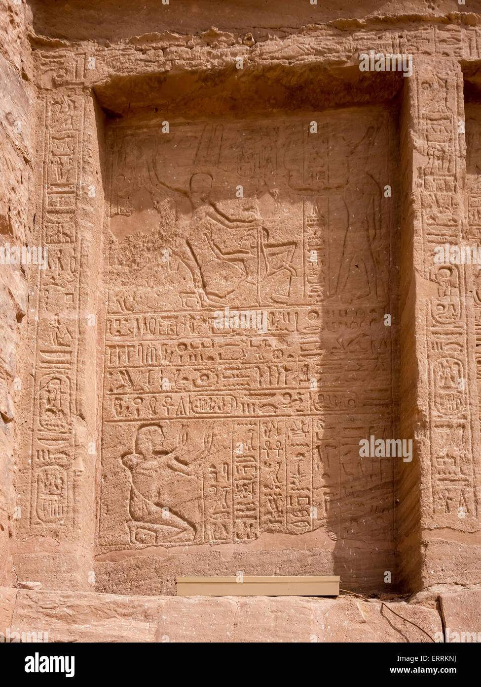 Relief at the Temple of Abu Simbel depicting Ramses II holding his enemies by the hair whilst the God Amun offers - Stock Image