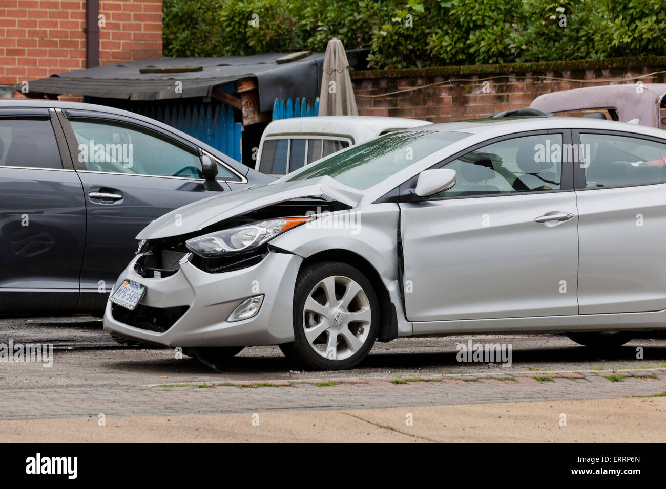 Car with front end collision damage - USA - Stock Image