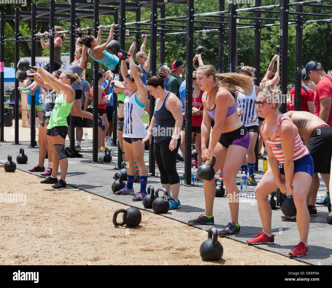 Crossfit trainees performing kettlebell lifts - USA - Stock Image