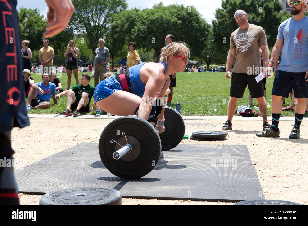 Woman performing weightlifting at an outdoor fitness program - USA - Stock Image