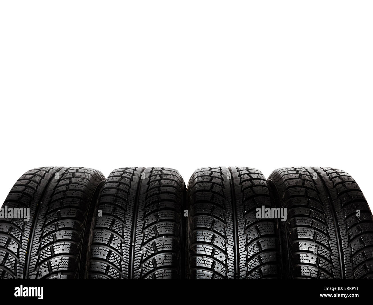 Set of winter tires, car snow tyres isolated on white background - Stock Image
