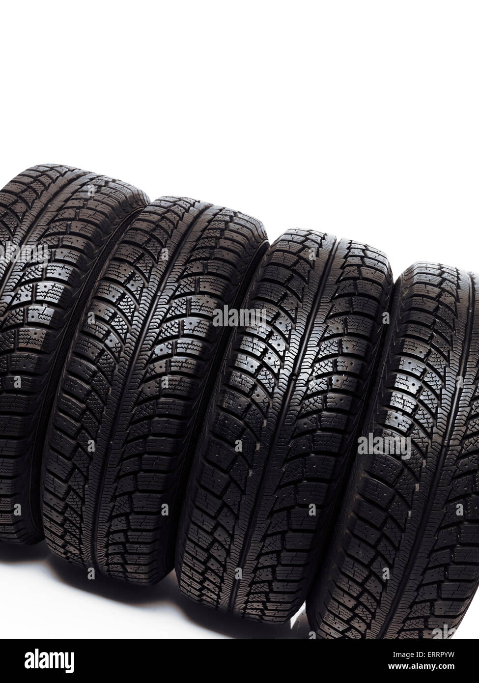 Set of winter tires, snow tyres isolated on white background - Stock Image