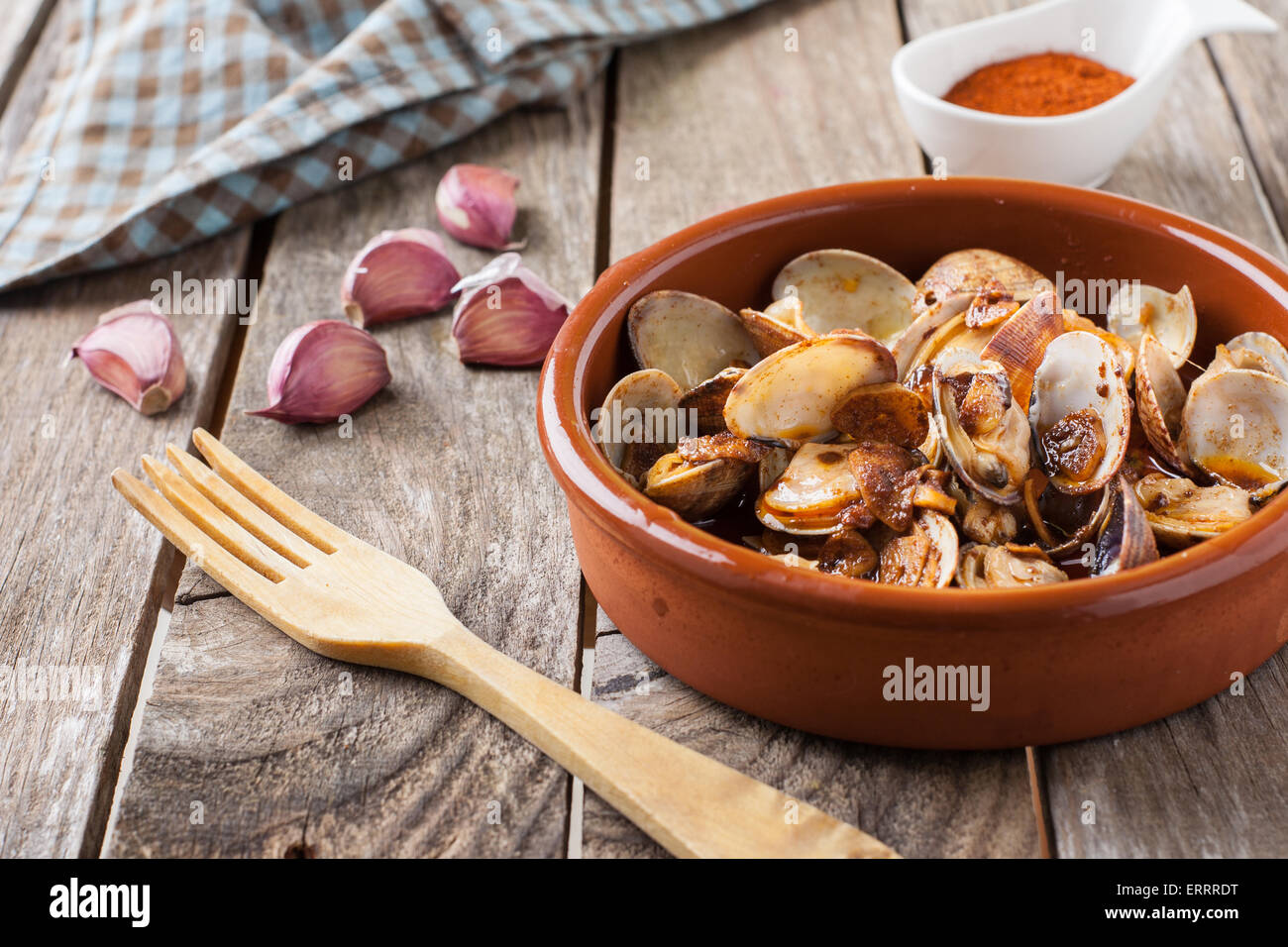 clams with garlic  at paprika spanish seafood style - Stock Image