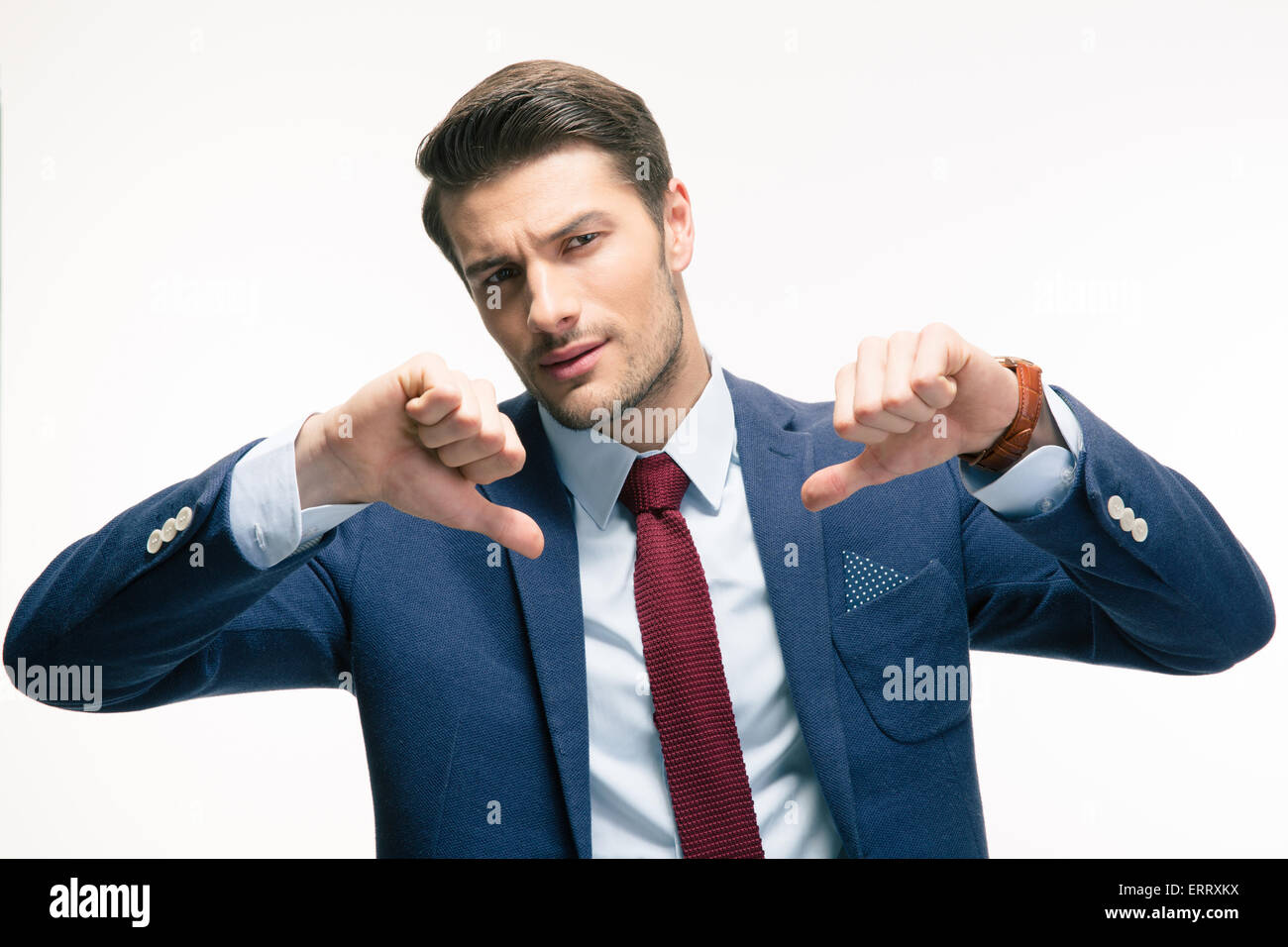 Confident businessman showing thumbs down sign isolated on a white background. Looking at camera - Stock Image