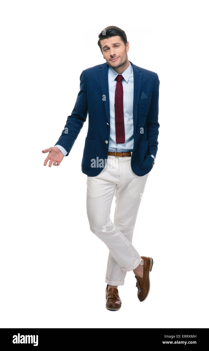 Full length portrait of a handsome businessman shrugging shoulders isolated on a white background - Stock Image