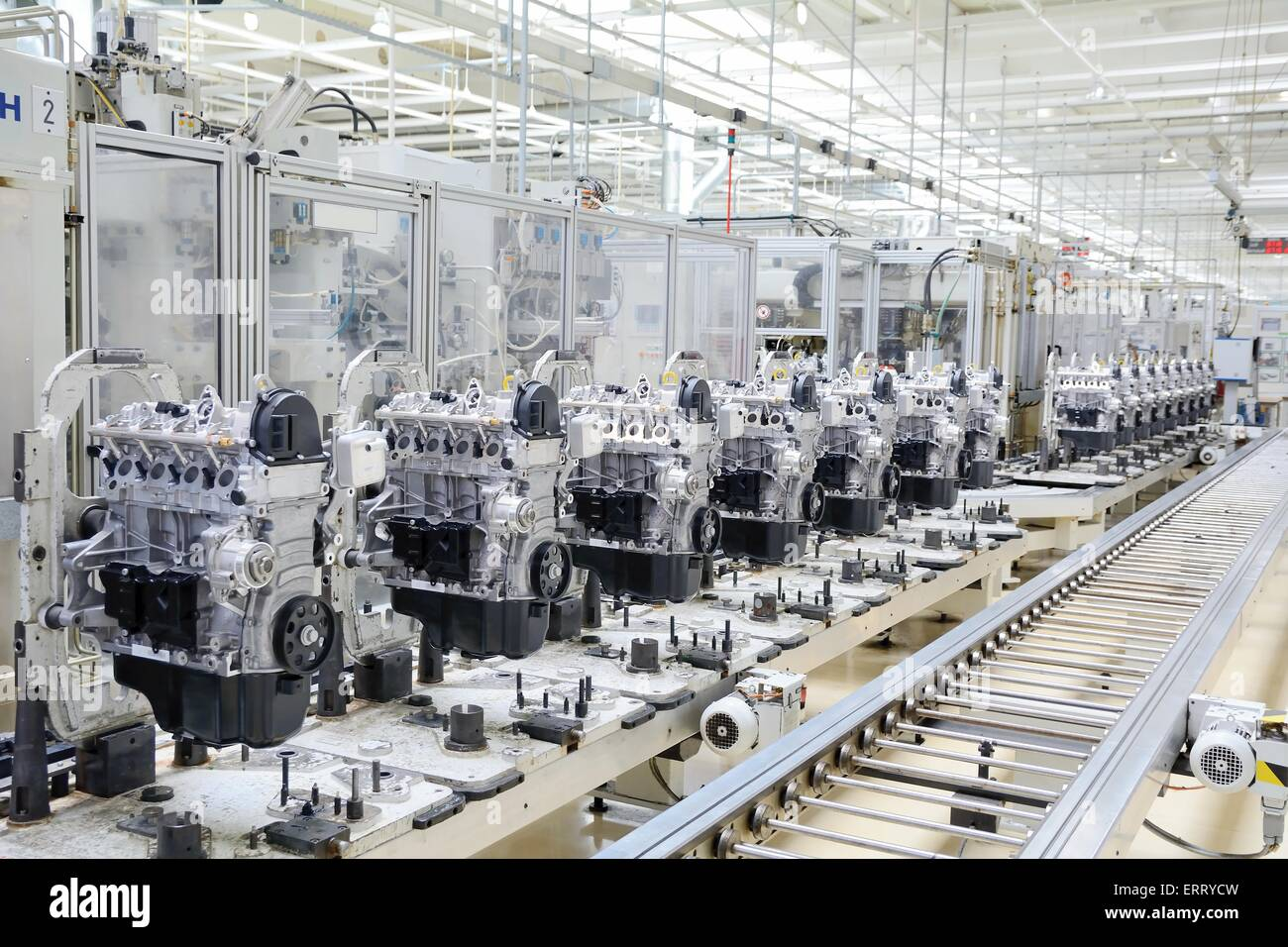 Production line for manufacturing of the engines in the car factory. - Stock Image