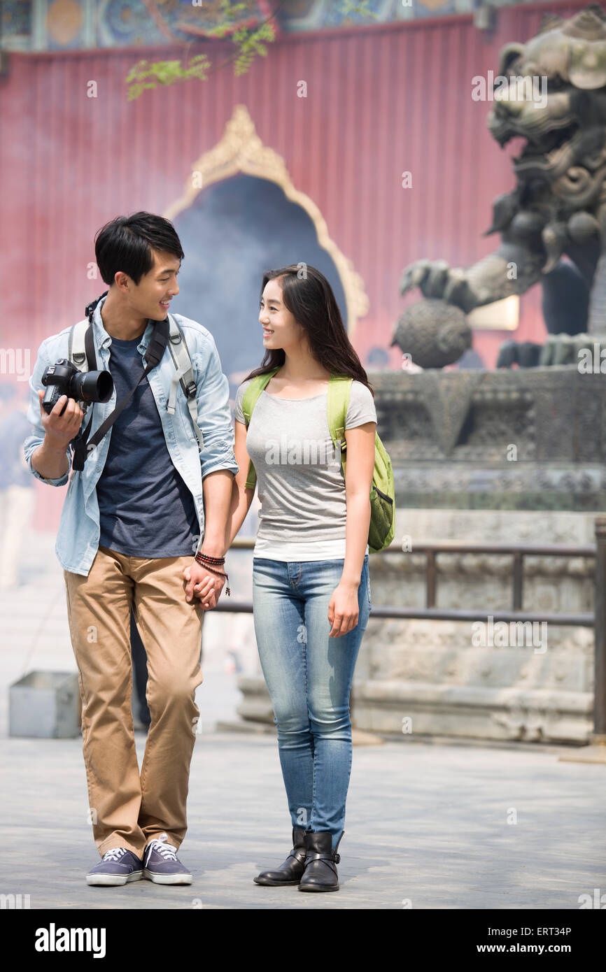 149179f1f1 Young couple travelling at the Lama Temple with camera Stock Photo ...