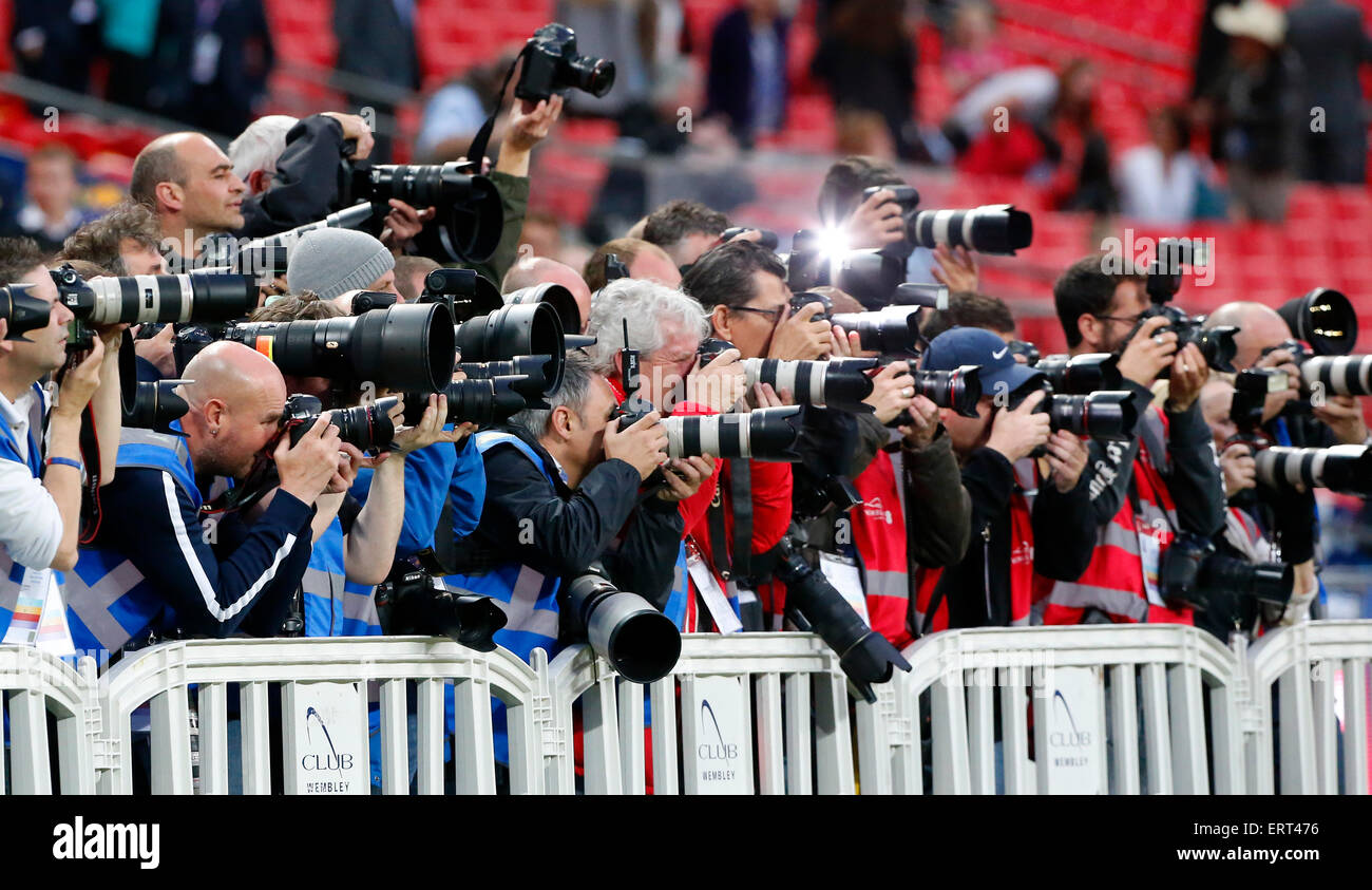 Professional Photographers working at a sports event. - Stock Image