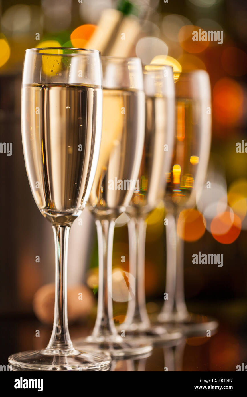 Celebration theme with row of glasses of champagne. - Stock Image