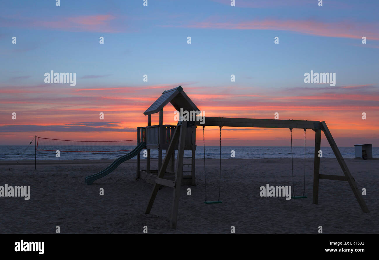 Deserted playground on the beach at sunset, in Katwijk aan Zee, a popular seaside village, South Holland, The Netherlands. - Stock Image