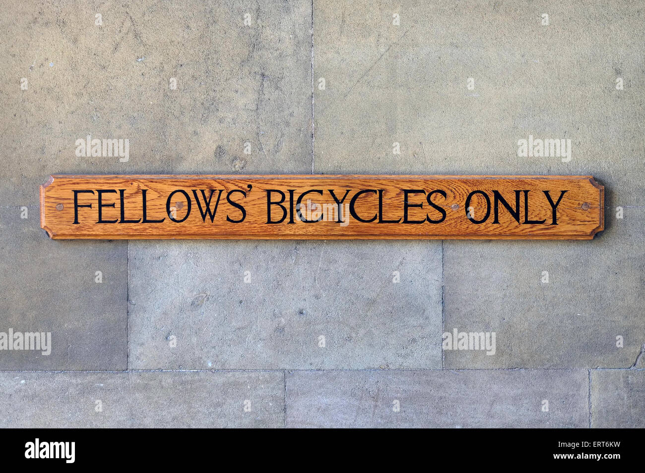 fellows' bicycles only sign on college wall, cambridge, cambridgeshire, england - Stock Image