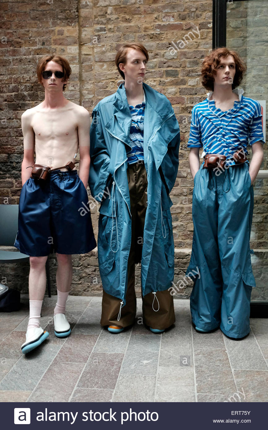 Backstage at Central Saint Martins,University Of The Arts, Granary Square. Models wearing BA graduate student  Gabriel - Stock Image