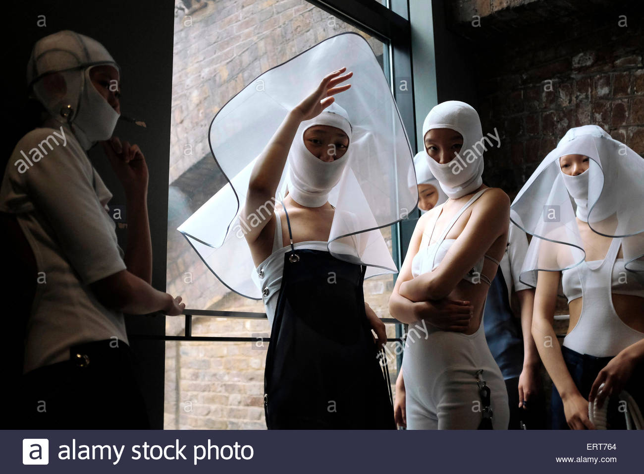 Womenswear models backstage at Central Saint Martins ,University Of The Arts, Granary Square. Wearing  BA Graduate - Stock Image