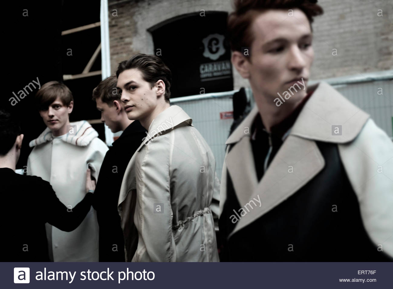 Menswear models backstage at Central Saint Martins,University Of The Arts, Granary Square. - Stock Image