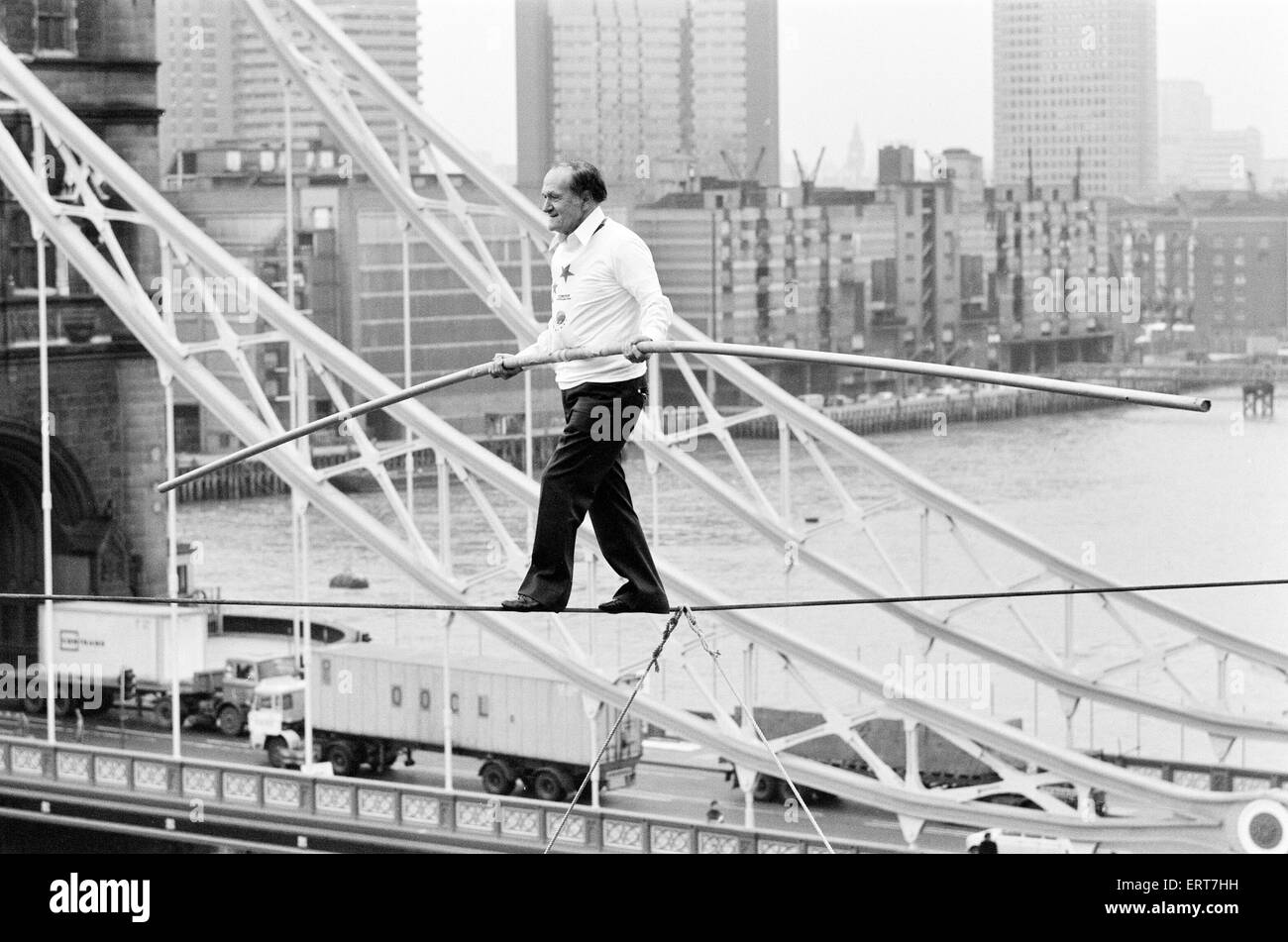 Karl Wallenda, Tightrope Walker, crosses 100ft above the ground, near Tower Bridge, London, Monday 22nd November - Stock Image