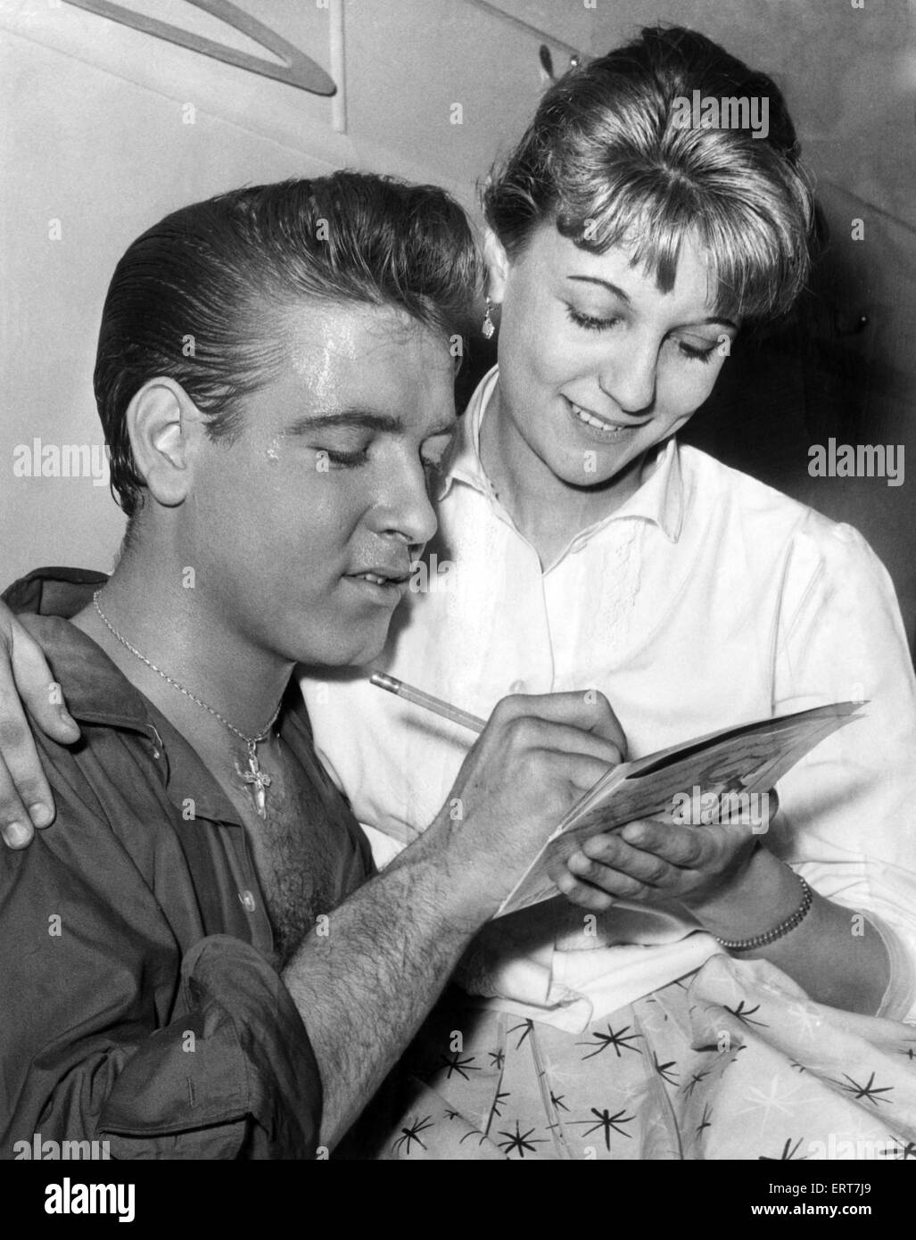 Eddie Cochran, Singer, signs autograph for fan Ann Berwick from Hay Mills, Birmingham, after concert at the Hippodrome, - Stock Image