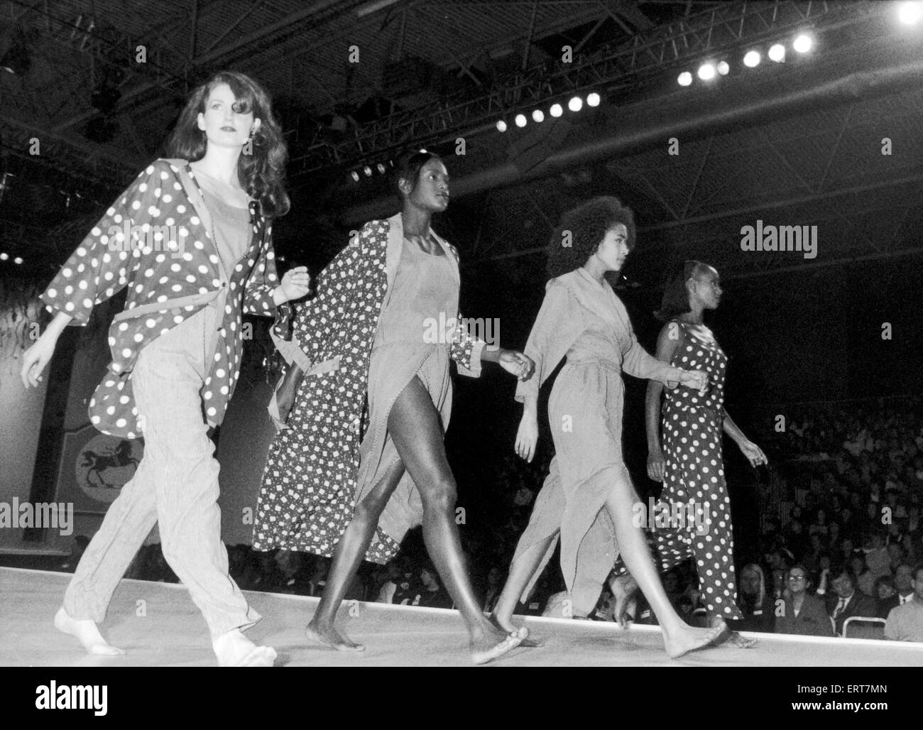 Clothes Show Live, models in spots and dresses slit to the waist stride out on the catwalk, Birmingham, 6th December - Stock Image