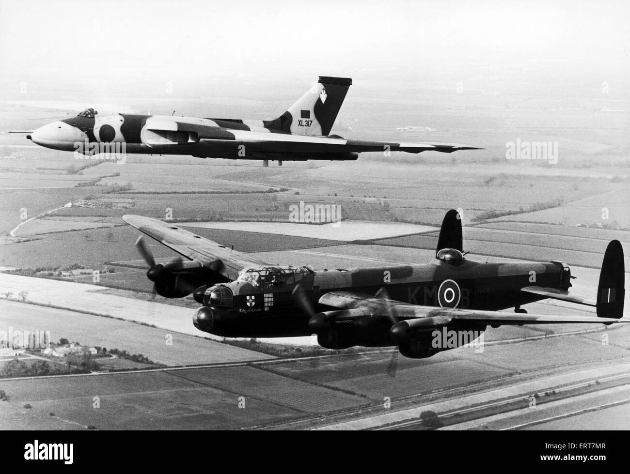 Avro Lancaster bomber commemorative flight over Derwent Dam, seen here escorted by an Avro Vulcan during the Coventry - Stock Image