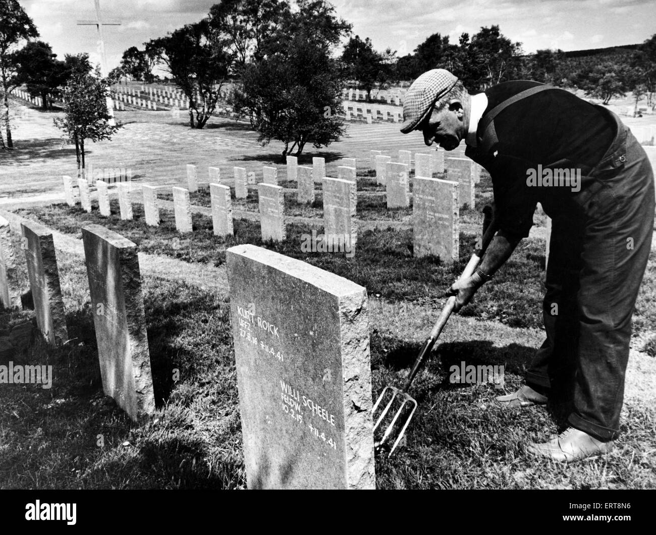 Mr Thomas Fox tidying graves at the German War Cemetery on Cannock Chase, ahead of it's opening. German youth - Stock Image