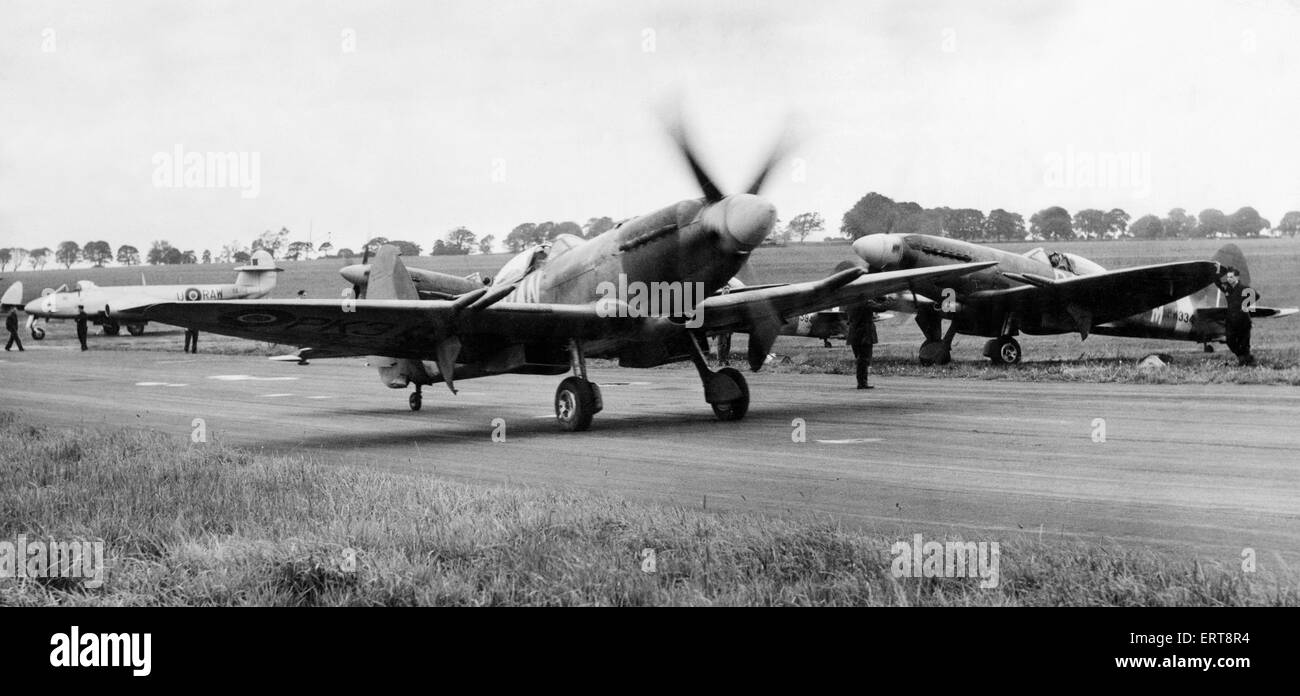 Spitfire fighter planes of 607 County of Durham Squadron, taxi around for the take off at the home of the RAF Station - Stock Image