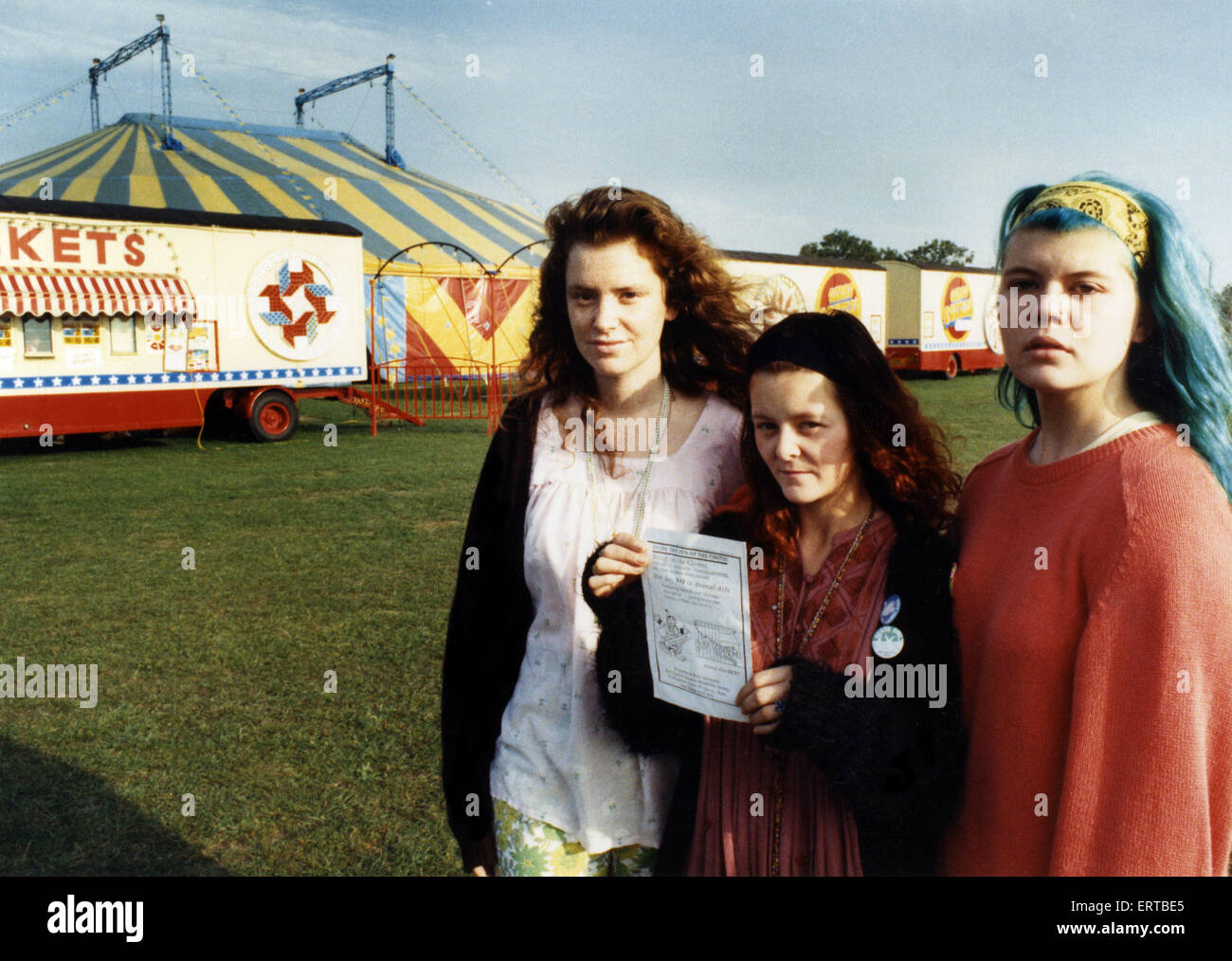 Animal rights campaigners with one of their leaflets, protesting at Gerry Cottle's Circus, Preston Park, Stockton. - Stock Image