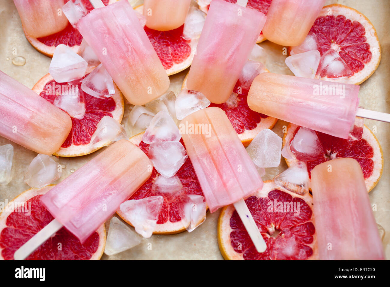 Fruity popsicles with ice and bloodorange - Stock Image