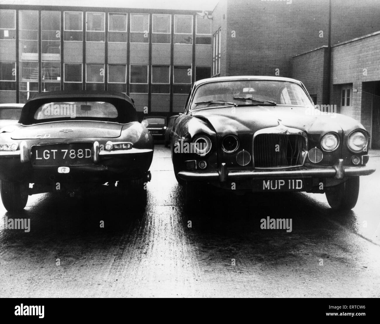 Mark X Jaguar saloon car (right), owned by murder victim Angus Sibbett, in which he was found lying across the back - Stock Image