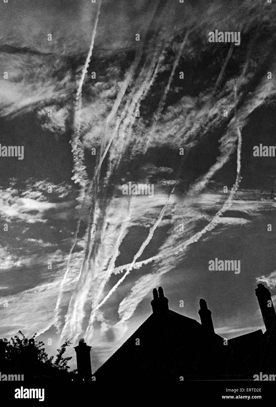 Vapour trails over London as planes speed to Normandy, Northern France during the Second World War. June 1944. - Stock Image