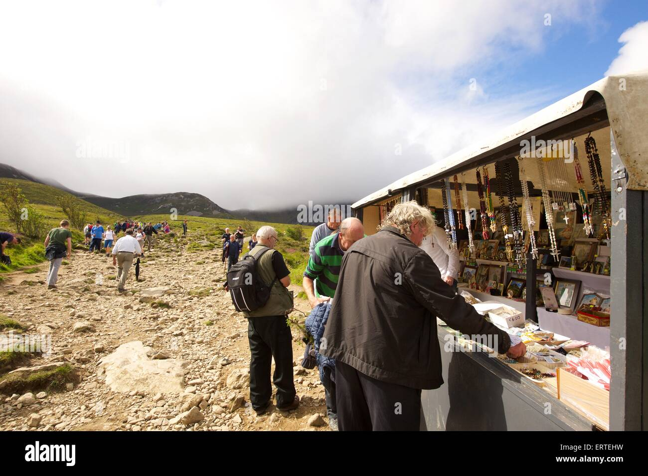 People buying religious items before climbing Croagh Patrick a holy mountain in County Mayo in the West of Ireland. - Stock Image