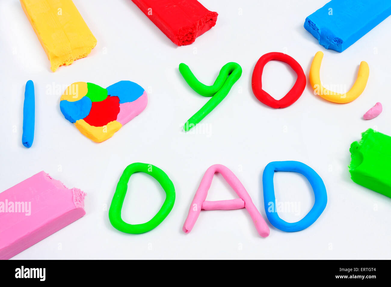 the text I love you dad made from modeling clay of different colors - Stock Image