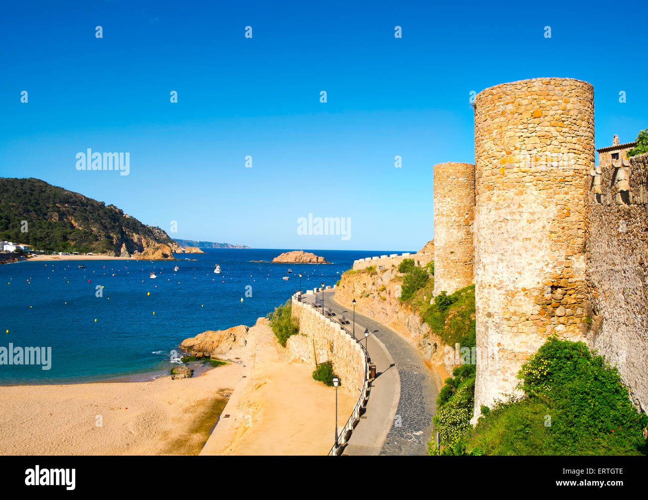 a view of the Platja Gran beach and the walls of the Vila Vella, the old town, of Tossa de Mar, Spain - Stock Image