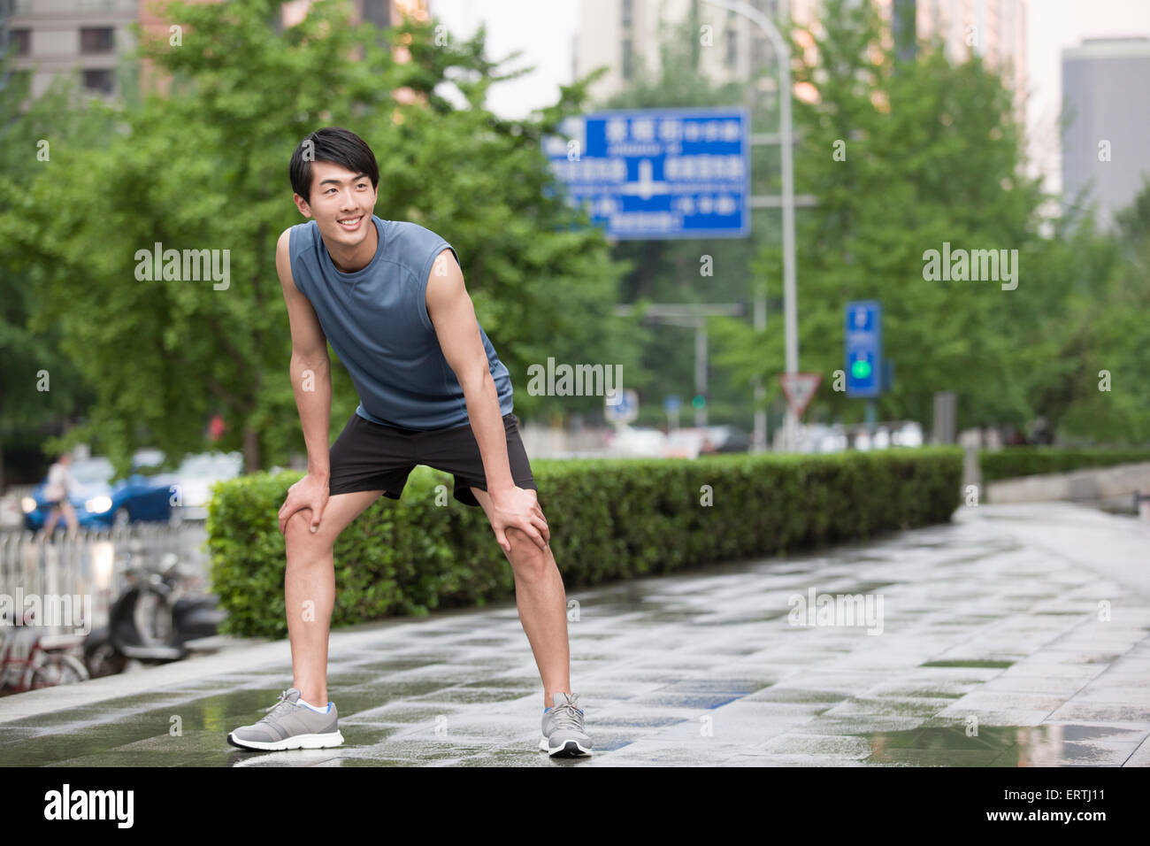 Young man taking a break from exercise - Stock Image