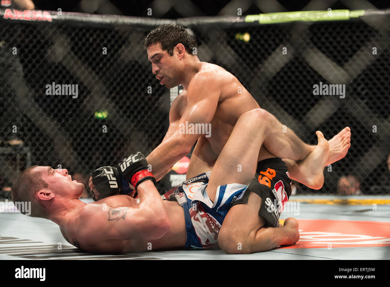 Fighters in the UFC MMA Ultimate Fighting Championship fight wrestle and grapple inside the octagon cage - Stock Image