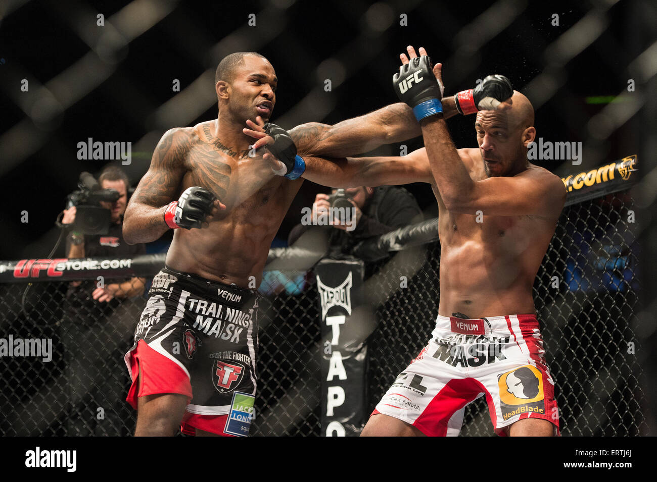 Jimi Manuwa punches out at Cyrille Diabate in The UFC Ultimate fighting Championship at Wembley Arena In London - Stock Image