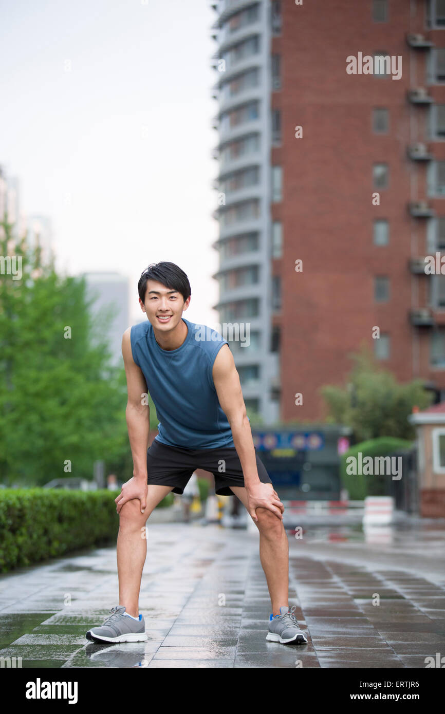 Young man taking a break from exercise Stock Photo